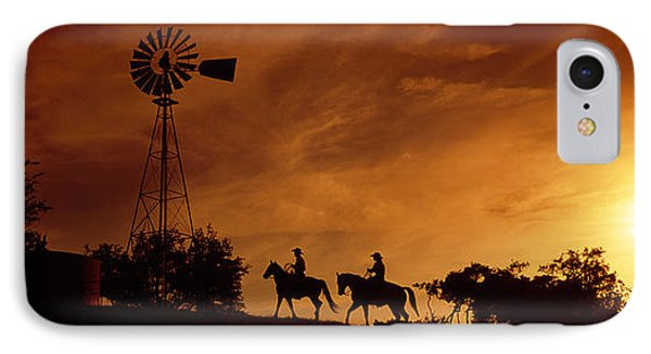Silhouette Of Two Horse Riders IPhone Case by Panoramic Images