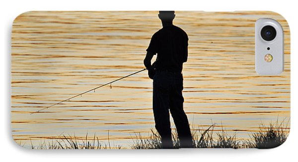 IPhone Case featuring the photograph Silhouetted Fisherman by Teresa Blanton
