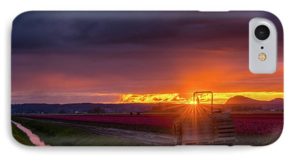 IPhone Case featuring the photograph Skagit Valley Tractor Sunstar by Mike Reid