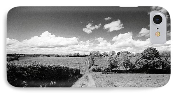 Small Worn Concrete Laneway Leading To Farmland In Rural County Monaghan At Tydavnet Republic Of Ire IPhone Case by Joe Fox