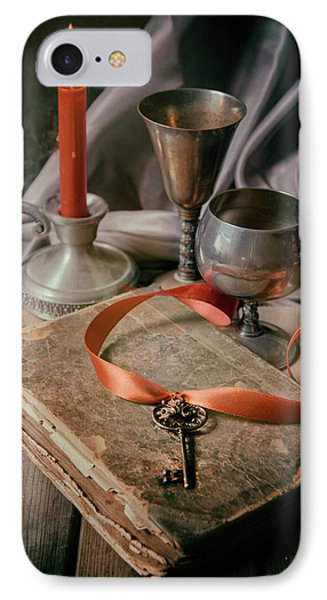 IPhone Case featuring the photograph Still Life With Old Book And Metal Dishes by Jaroslaw Blaminsky