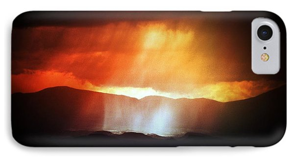 IPhone Case featuring the photograph Storm Glow Night Over Santa Fe Mountains by Joseph Frank Baraba