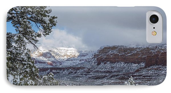 IPhone Case featuring the photograph Sunlit Snowy Cliff by Laura Pratt