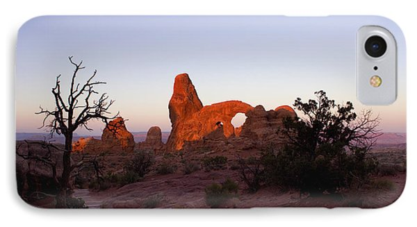 Sunrise At Tower Arch IPhone Case by Ellen Heaverlo