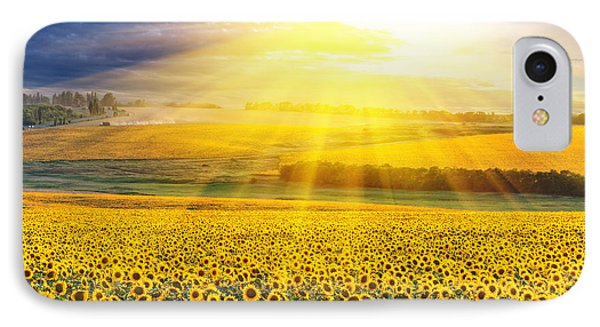 Sunset Over The Field Of Sunflowers Against A Cloudy Sky IPhone Case by Caio Caldas