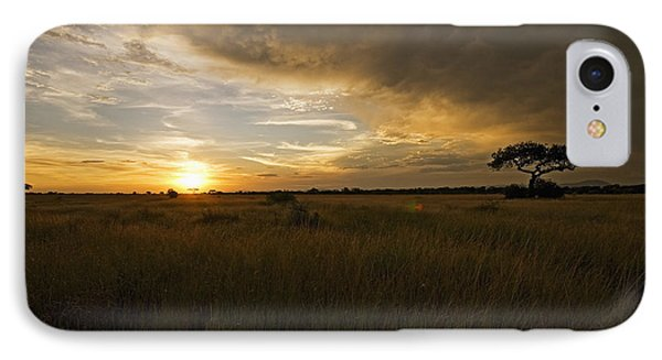 sunset over the Serengeti plains IPhone Case by Patrick Kain