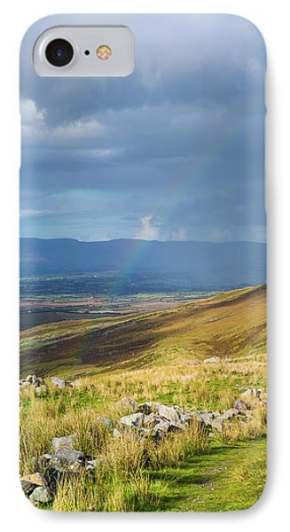 IPhone Case featuring the photograph Sunshine And Raining Down With Rainbow On The Countryside In Ire by Semmick Photo