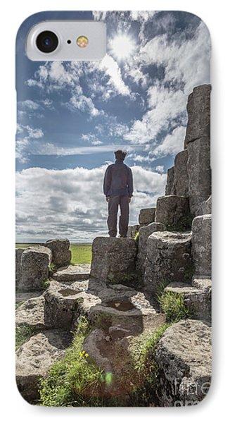 IPhone Case featuring the photograph Teen Boy Standing On Basalt Rocks by Edward Fielding