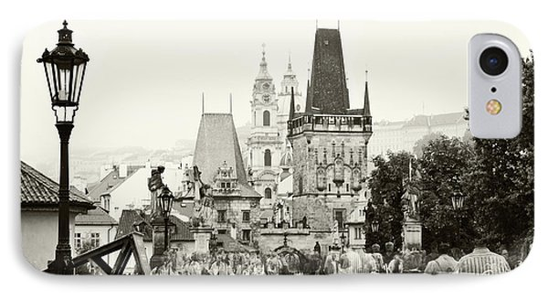 IPhone Case featuring the photograph The Stream Of People On Charles Bridge. Prague by Jenny Rainbow