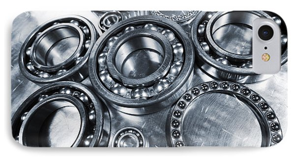 IPhone Case featuring the photograph Titanium And Steel Ball-bearings by Christian Lagereek
