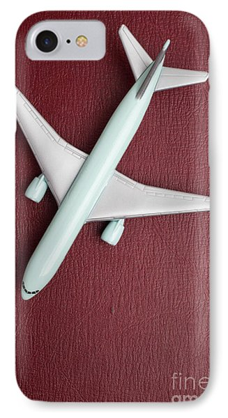 IPhone Case featuring the photograph Toy Airplane Over Red Book Cover by Edward Fielding