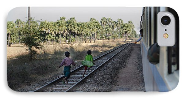 IPhone Case featuring the photograph Two Kids Run Along And Follow Train In Burma by Jason Rosette