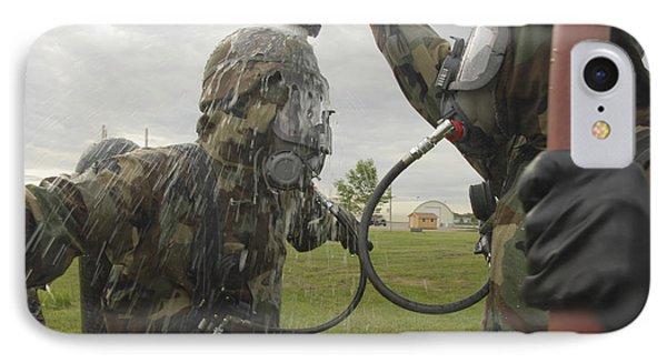 U.s. Air Force Soldier Decontaminates Phone Case by Stocktrek Images