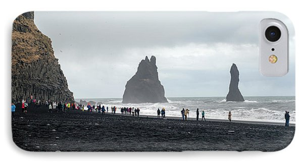 IPhone Case featuring the photograph Visitors In Reynisfjara Black Sand Beach, Iceland by Dubi Roman