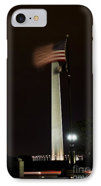 IPhone Case featuring the photograph Washington Monument At Night With Flag by Angela DeFrias