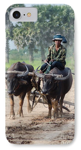 IPhone Case featuring the photograph Waterbuffalo Driver Returns With His Animals At Day's End by Jason Rosette