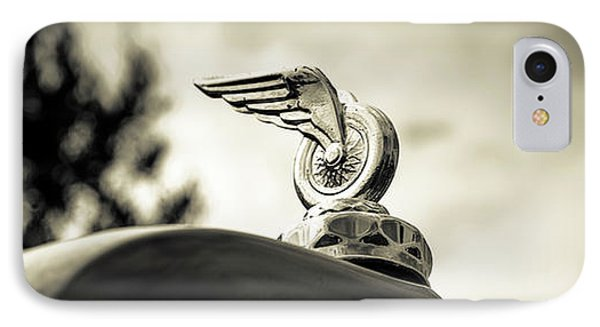 IPhone Case featuring the photograph Winged Wheel by Caitlyn Grasso