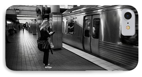 woman checking smartphone as train arrives at septa 2nd street underground subway station Philadelph IPhone Case