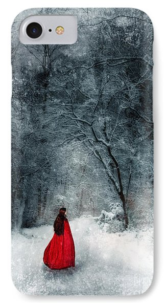 Woman In Red Cape Walking In Snowy Woods Phone Case by Jill Battaglia