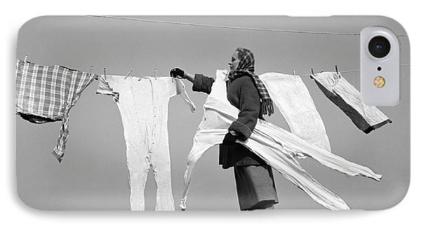 Woman Removing Frozen Clothes IPhone Case by Debrocke/ClassicStock