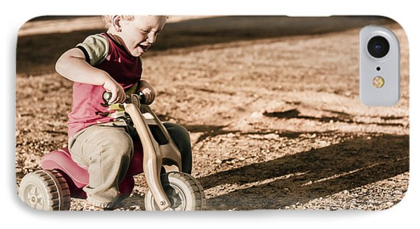 Young Boy Breaking At Fast Pace On Toy Bike IPhone Case by Jorgo Photography - Wall Art Gallery