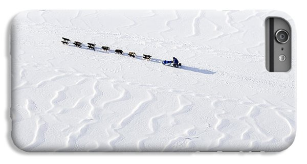 John Bakers Team Running Down Frozen Yukon River  IPhone 7 Plus Case by Jeff Schultz