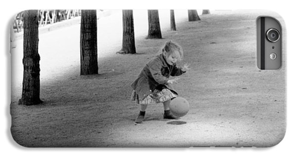 IPhone 7 Plus Case featuring the photograph Little Girl With Ball Paris by Dave Beckerman