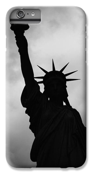 IPhone 7 Plus Case featuring the photograph Statue Of Liberty Silhouette by Dave Beckerman