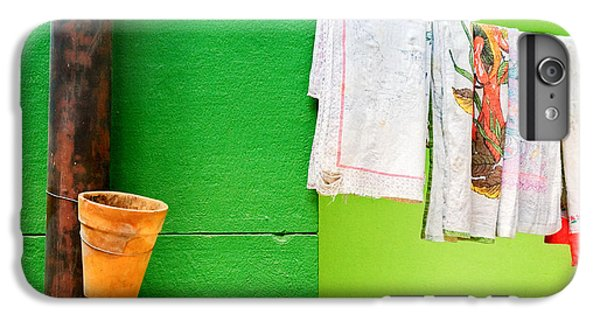 IPhone 7 Plus Case featuring the photograph Vase Towels And Green Wall by Silvia Ganora