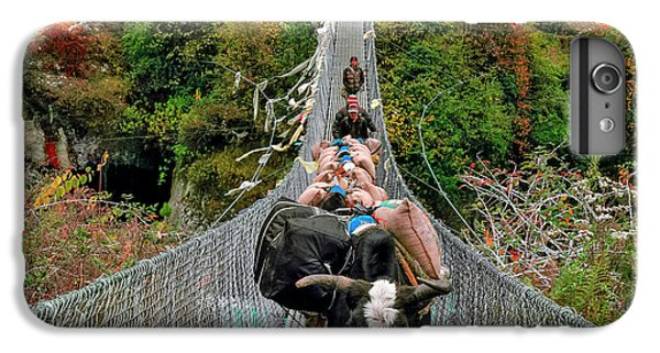 Yaks On Rope Bridge IPhone 7 Plus Case by Babak Tafreshi