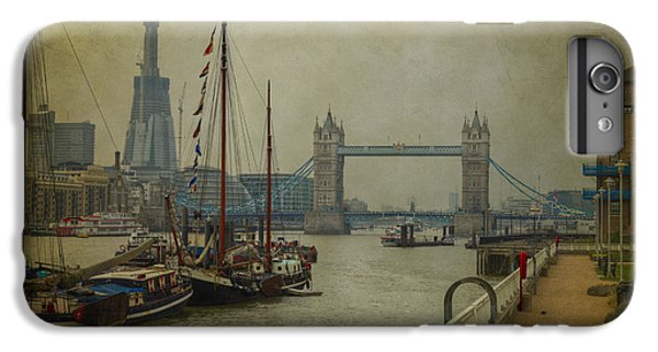 IPhone 7 Plus Case featuring the photograph Moored Thames Barges. by Clare Bambers