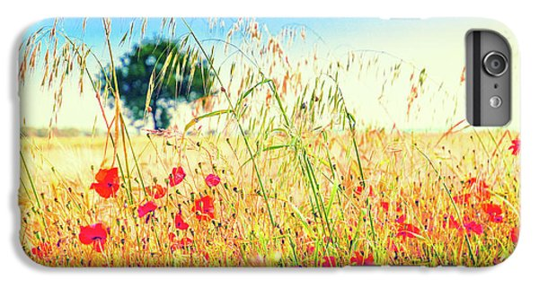 IPhone 7 Plus Case featuring the photograph Poppies With Tree In The Distance by Silvia Ganora