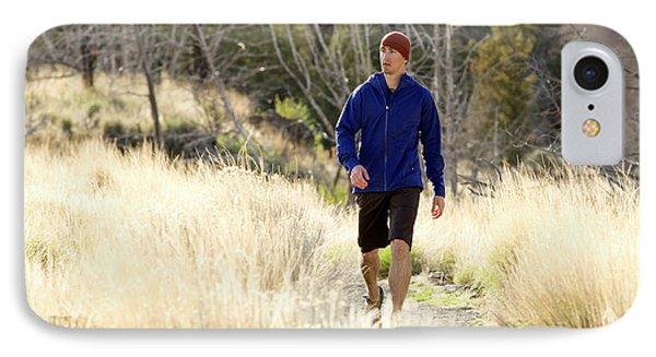Knit Hat iPhone 8 Case - A Man In A Blue Jacket Walks by Jordan Siemens