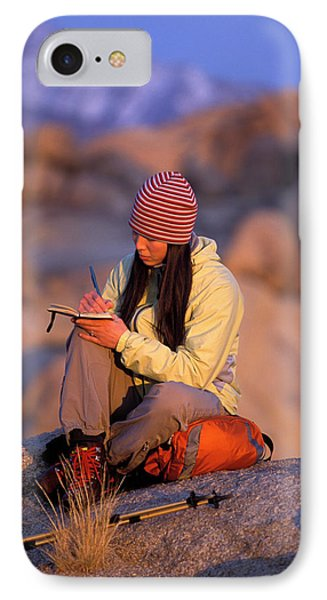 Knit Hat iPhone 8 Case - A Woman Sits And Writes In Her Journal by Corey Rich