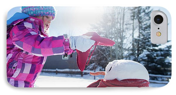 Knit Hat iPhone 8 Case - A Young Girl Building A Snowman by Mike Schirf