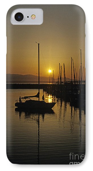 Silhouetted Man On Sailboat IPhone Case