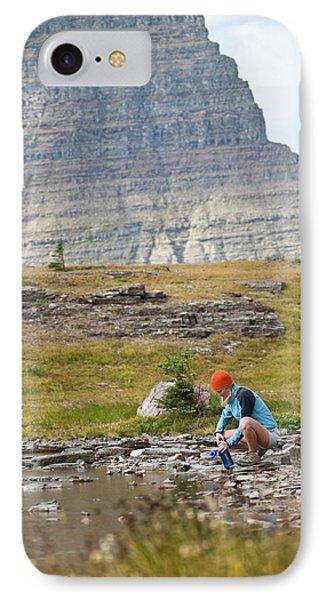 Knit Hat iPhone 8 Case - Solo Female Camper Filtering Water by Heath Korvola