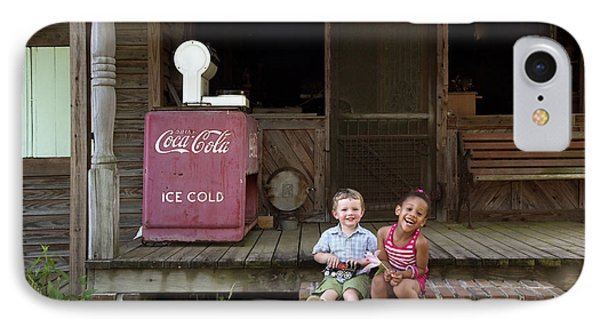 Two Young Children Pose On The Steps Of A Historic Cabin In Rural Alabama IPhone Case