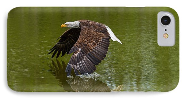 Bald Eagle In Low Flight Over A Lake IPhone Case