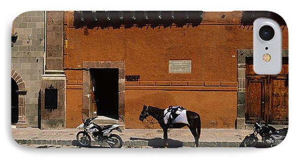 Horse Standing Between Two Motorcycles IPhone Case