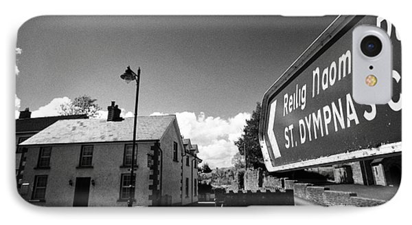 St Dympnas Cemetary Sign Pointing Past Old Traditional Whitewashed House In Tydavnet County Monaghan IPhone Case
