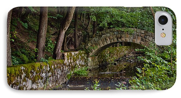 Stone Arch Bridge Path And Flowing Creek Stream In Lush Forest Countryside Landscape IPhone Case
