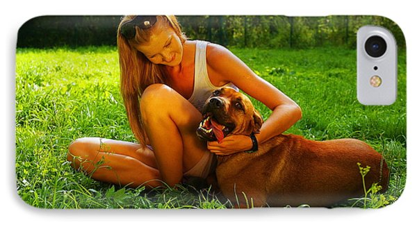 Young Beautiful Woman With Blonde Hair Is Playing With A Mastif Dog In A Backyard With Green Grass IPhone Case