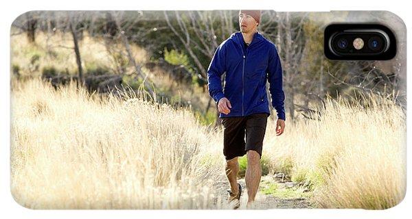Knit Hat iPhone XS Max Case - A Man In A Blue Jacket Walks by Jordan Siemens
