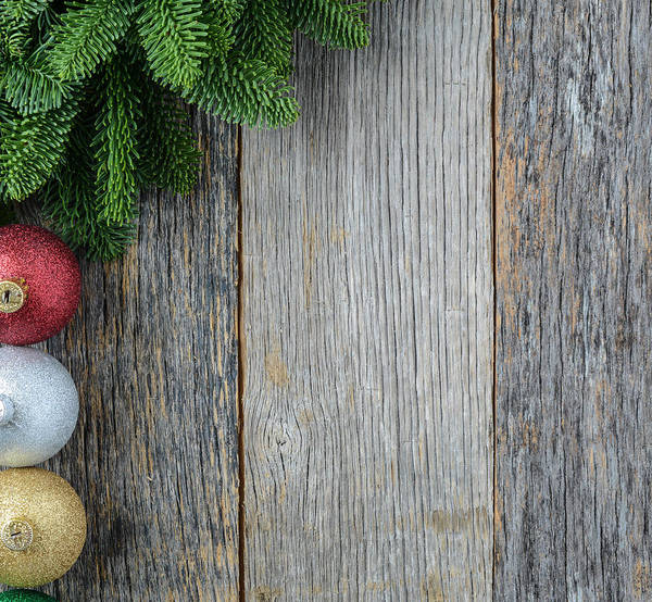 Christmas Pine Needle And Ornaments On A Rustic Wood Background Poster