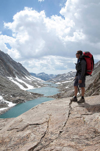 Hiker Enjoys The Views Above The Darwin Poster