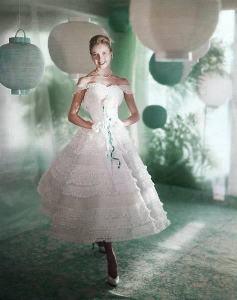 Model Wearing White Dress Poster