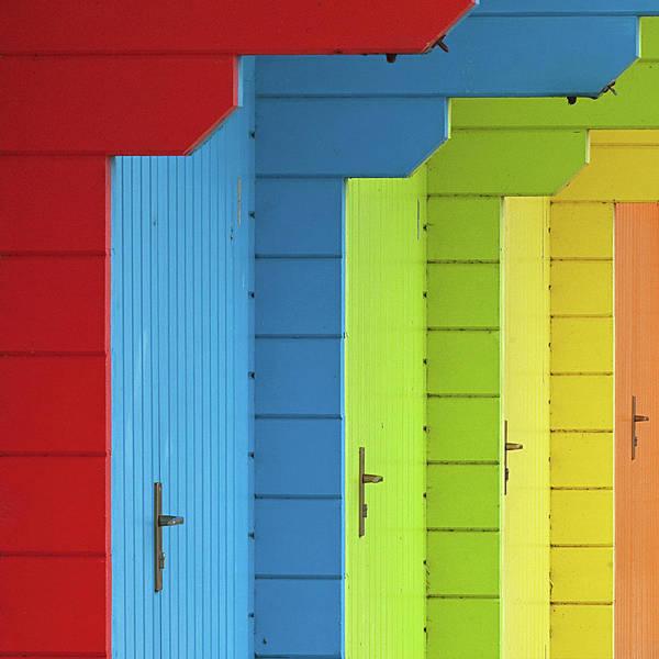 Multi-coloured Beach Huts Poster