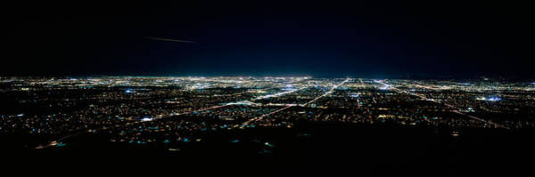 Aerial View Of A City Lit Up At Night Poster