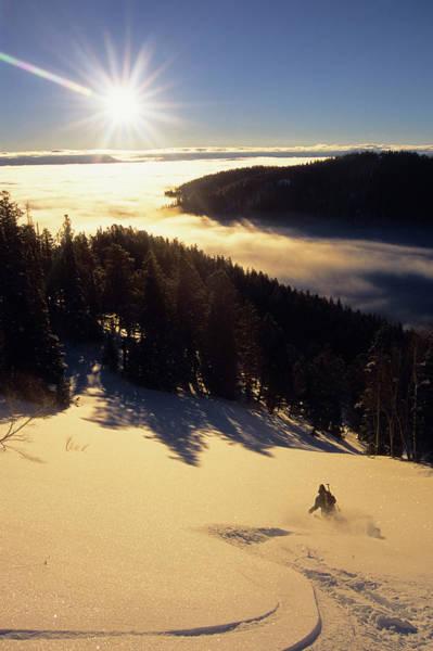 A Backcountry Skier Makes Tracks Poster